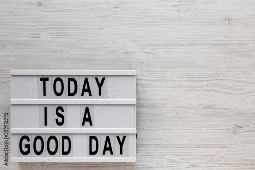 Fototapety, obrazy: 'Today is a good day' words on a lightbox on a white wooden background, top view. Overhead, from above, flat lay. Copy space.