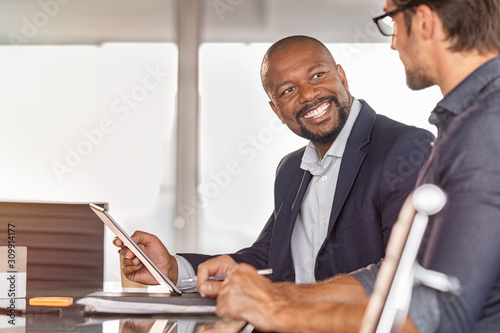 African businessmen in a conversation with colleague