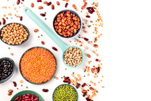Pulses. Legumes Assortment On A White Background, Overhead Shot With A Place For Text. Black And Red Beans, Lentils, Chickpeas, Soybeans, A Flatlay With Copyspace