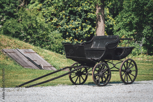 Old wooden horse carriage outdoors in summertime Fototapete
