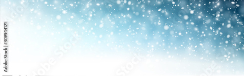 Winter blue horizontal background with white defocused snowflakes Canvas Print