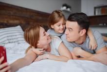 Emotional Happy Parents Lying ...