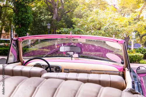 Pink old american classic car in Havana, Cuba Wallpaper Mural