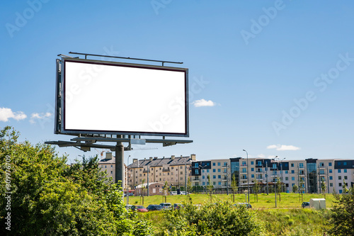 Obraz Blank white billboard for advertisement on the residential area. Sunny summer day in the city. - fototapety do salonu
