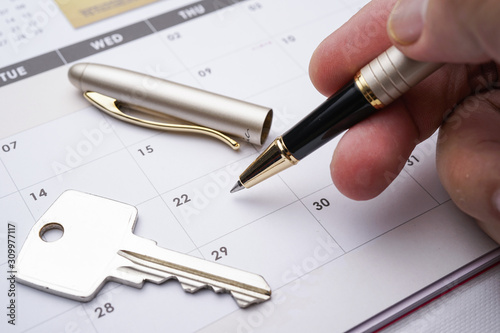 Photo A Property conceptual, calendar with hand written vacant possession VP