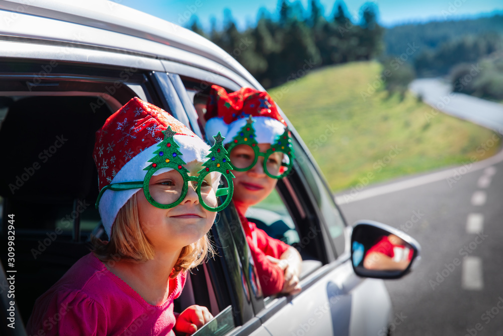 christmas car travel- happy boy and girl travel in winter