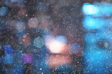 city lights snow glow background blurred / cityscape blurred bokeh, snowy weather seasonal background winter December