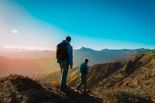 Father And Son Hiking In Sunse...