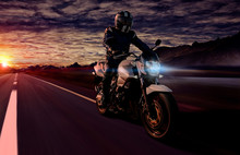 Motorcyclist At Night Riding O...