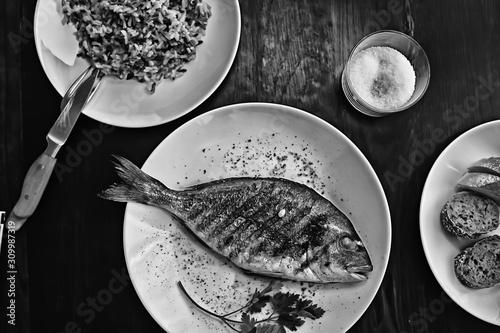 Obraz na plátně  dorado grill in a restaurant / fish fried in a restaurant, a beautiful seafood g