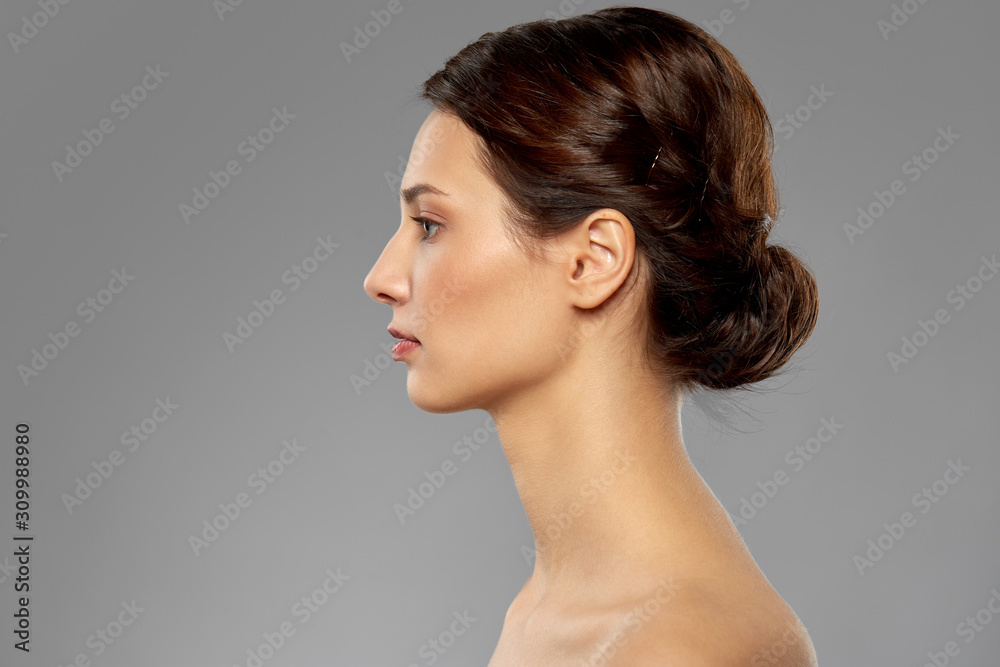 Fototapeta beauty, bodycare and people concept - profile of beautiful young woman with bare shoulders over grey background
