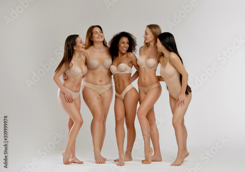 Fototapeta Group of women with different body types in underwear on light background obraz na płótnie