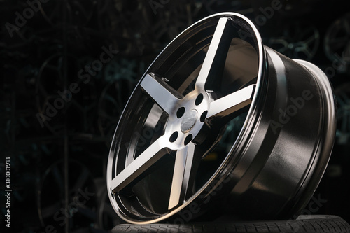 cast aluminum disc alloy wheel modern, close-up on black background, spokes and Canvas