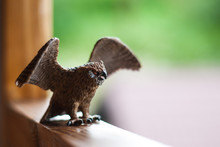 Owl Toy Figure Sitting On A Wo...