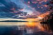 canvas print picture - direkt am Ufer atmosphärische, strahlende, Sonnenuntergang, leuchtende  Wolken, glitzernde Wasserfläche, Lindau, Bodensee, Lindenhofpark