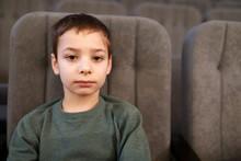 Kid Posing In Theater