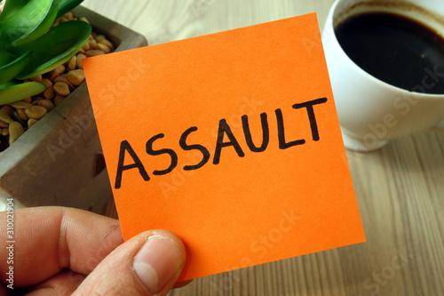 Assault word handwritten on sticky note Wallpaper Mural