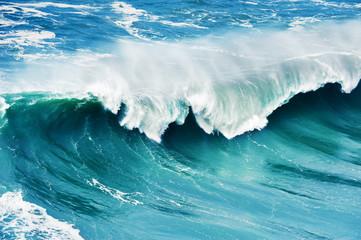 FototapetaBig waves on the coast of Atlantic ocean. Nazare, Portugal. Beautiful nature background
