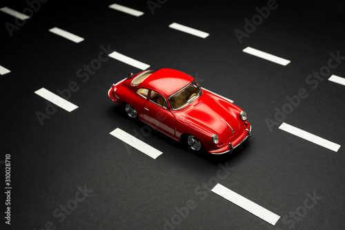 Top and front view of a Porsche Carrera 2 toy model car on a blue background Fototapete
