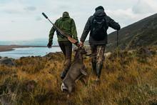 Hunters Pulling Dead Deer