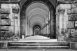 canvas print picture - Greyscale shot of a concrete ancient building with a long hallway