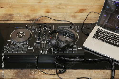 DJ equipment controller and headphones and laptop. Music background, banner, card. Modern technologies - 310032795
