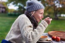 Woman Eating In Garden