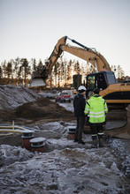 People At Work Near Digger