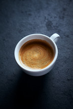 Cup Of Coffee On Dark Stone Ba...