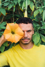 Portrait Of Man With Blossom Of Angel's Trumpet