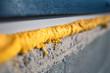 DIY concept. Construction PU - poly urethane foam. The window is installed using a mounting foam. Installation foam