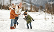 canvas print picture - happy family mother and children having fun on winter walk
