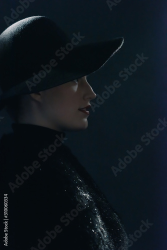 Vintage 1940s woman in black hat. Side view. Canvas Print