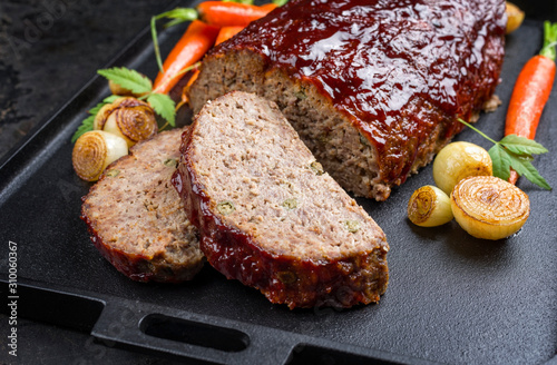 Fotografie, Obraz Traditional American meatloaf with ketchup from ground beef with carrots and oni