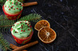 christmas green cupcake with whipped cream, decorated with christmas tree