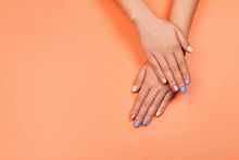 Manicure In Trendy Colors: Coral, Rose Gold And Blue On Colorful Background. Flat Lay Style.