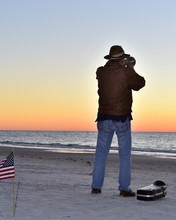 A Veteran Trumpeter Plays A Tune At Sunset In Honor Of The Fallen Every Night At Indian Rocks Beach Florida