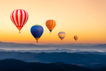 Colourful Hot Air Balloons Flying Over The Mountain