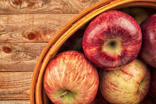 Apples Basket Disposed On A Wo...