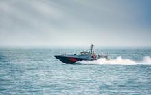 A Coast Guard Patrol Boat Sails Near The Shore