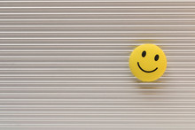 Funny Smiley Face On Silver Background. Positive Mood Concept.