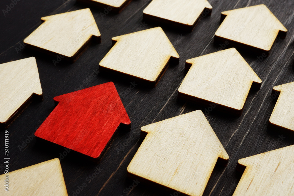 Fototapeta Property management concept. Red home model and wooden ones.