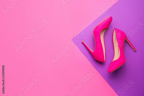 Stylish female shoes on color background - 310114188