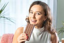 Young Woman Enjoying A Chocola...