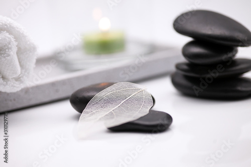 Photo Wellness with stones and candle and buddha