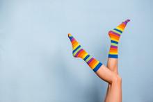 Legs In Funny Socks On Blue Backgroundt