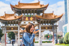 Asian Traveler Woman Using Sma...