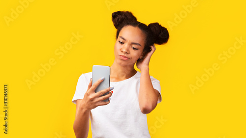 Upset black teenager received disappointing news on feed Fototapet