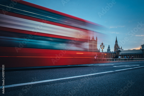 Scene of Westminster Bridge seen from South Bank, quiet morning double decker bus and fast moving Canvas Print