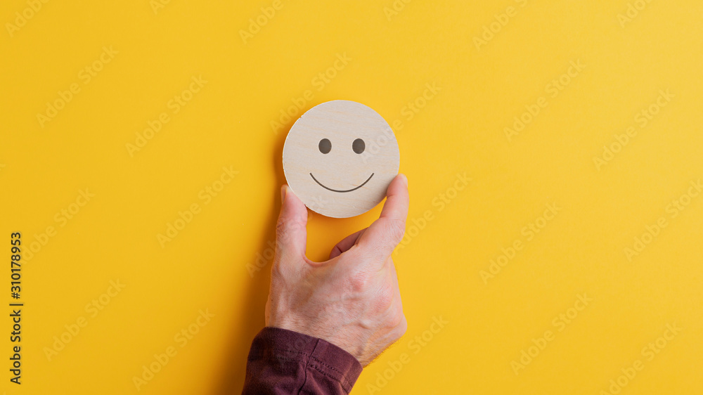 Fototapeta Wooden cut circle with smiling face on it